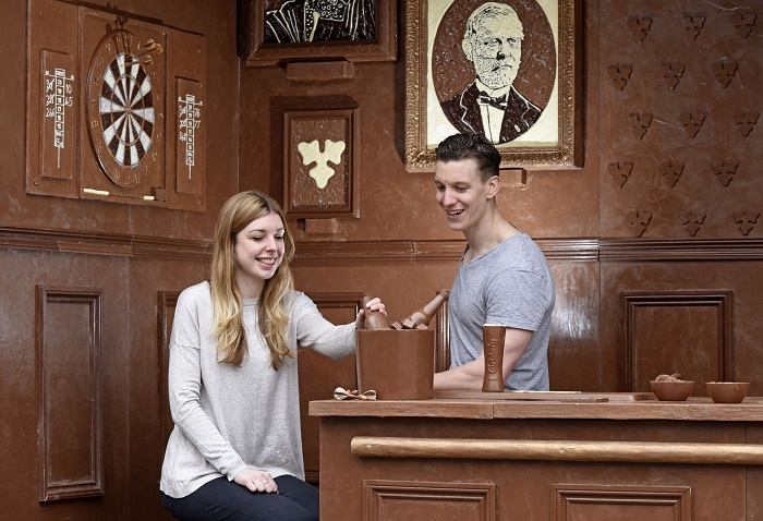 If Carlsberg did chocolate bars... Pictured: Two punters enjoying a beer at the Carlsberg chocolate bar.