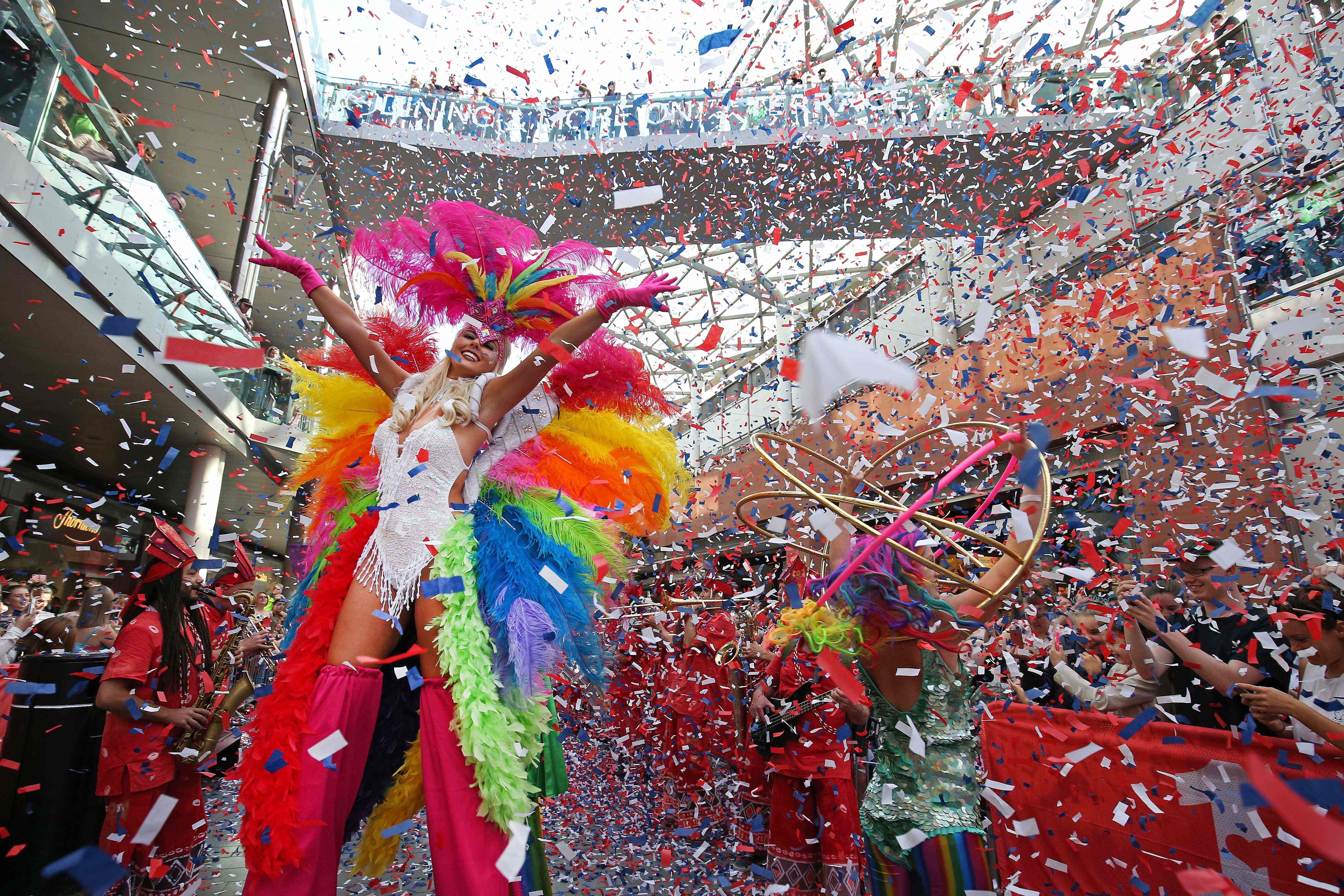 Liverpool One Samba parade performances and shoppers.. Images by Gareth Jones