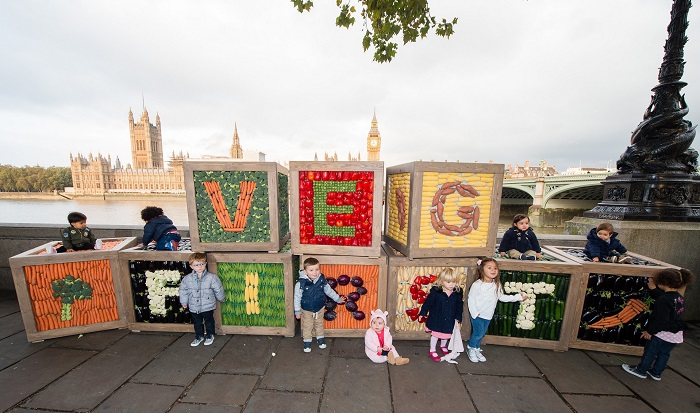 EDITORIAL USE ONLY A group of children and toddlers with large building blocks made of vegetables, created by EllaÕs Kitchen, on their way to the Department of Health to raise awareness of the importance of vegetables during weaning and child development, London. PRESS ASSOCIATION Photo. Picture date: Thursday October 13, 2016. Research found that one in five British children are classified as overweight by the time they reach primary school. Photo credit should read: JEFF SPICER/PA Wire