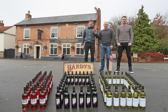 LOUGHBOROUGH, ENGLAND - NOVEMBER 09: Co Owner of the Three Crowns Inn Harry Gurney of Nottinghamshire Cricket Club, Head Coach Peter Moores of Nottingham Cricket Club and Alex Hales of Nottingham Cricket Club pose for the camera as they take delivery of 100 cases of Hardy's Wine for Stuart Broad's Pub to mark Broad's 100th Test Cap on November 9, 2016 in Loughborough, England. Hardy's Wine Ambassador Stuart Broad started his 100th Test match for England today against India in Rajkot. (Photo by Christopher Lee/Getty Images for Hardy's) *** Local Caption *** Harry Gurney; Peter Moores; Alex Hales