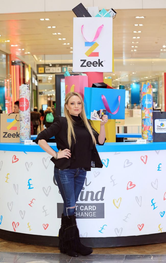 Rita Simmons, appeared at the Zeek Cash or Kind swap shop in Westfield, Stratford today helping shoppers swap unwanted gift cards for cash or donate the value to The Childrens Trust. Eastenders' Rita Simons swaps Albert Square for Westfield to launch swap-shop for unwanted gift cards. • Zeek's 'Cash or Kind' store at Westfield Stratford allows members of the public to swap unwanted gift cards for cash to keep or donate the value to charity • 47% of Brits admit they have received an unwanted gift card or voucher, with £300million wasted every year Today, former Eastenders star Rita Simons swapped her market stall in Albert Square to launch a pop-up shop in Westfield, Stratford. The shop allows members of the public to exchange their unwanted gift cards for cash or donate the value to The Children's Trust, a leading charity for children suffering from brain injury. The swap-shop, open for one day only, was set up by Europe's biggest gift card marketplace, Zeek, in response to new research showing that 47% of Brits have at one time received an unwanted gift card or voucher, with an estimated £300million of unused credit in the UK every year. The vast majority of unwanted items will be re-sold (23%) or re-gifted (33%), however one in seven (14%) will never see the light of day, gathering dust in drawers or even being relegated to the bin. The gift card swap shop comes at the perfect time of year as, contrary to widespread belief, the most popular week for returning unwanted items is the second week of January, with 15% choosing to wait until the festivities have died down before hitting the high street. A sizeable 70% of us even went as far as to say they actively avoid the shops between Boxing Day and the New Year with half of us citing crowds as a reason to avoid the high street. Rita Simons, who exited the popular BBC soap in an explosive storyline over New Year, opened the shop, as eager shoppers got ready to exchange their unwanted gift