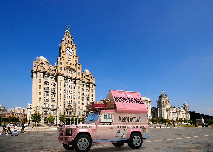 Liverpool, United Kingdom - June 11, 2015: The Three Graces consisting of the Liver Building, Port of Liverpool Building and the Cunard Building with tourists enjoying the sights, Liverpool, Merseyside, England, UK, Western Europe.