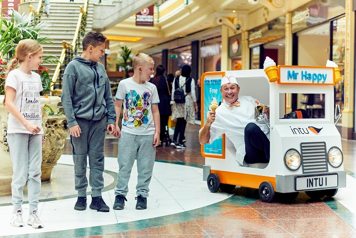 Stoop for a Scoop: The world's smallest ice cream van has been unveiled today, delivering free ice cream to shoppers at intu Trafford Centre. The Nice Cream Van measures just 47 inches long and 39 inches high with a maximum speed of 12MPH, and is going on a nationwide tour of 14 intu shopping centres to help make happier shoppers. The creation of the mini motor follows research revealing that eating ice cream is one of the top 20 things that make people happiest in the summer, with others on the list including walking barefoot in the grass, taking a trip to the beach, going on holiday and shopping for your summer wardrobe. For more information contact Neil Broderick at Shine on 07850 508 412 or at Neil@shinecom.com PR Handout – free for editorial usage Copyright: © Mikael Buck / intu
