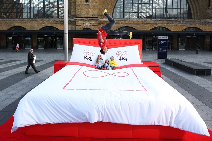 "Morning commuters were treated to a surprise today in London, seeing kids of all ages jumped for joy on Virgin TV""s giant 15 square metre bed at Kings Cross Station to celebrate the launch of it new Kids App, which offers 2,000 episodes of top TV shows, books and games."