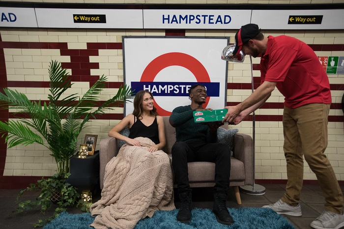 EDITORIAL USE ONLY L-R Amber O'Shea and Benjamin Opuku take part in a unique dining experience to launch Papa John's new 'Papa's Deep Crust' pizza on the platform at Hampstead station, the deepest tube station on the London Underground. PRESS ASSOCIATION Photo. Picture date: Thursday September 7, 2017. Photo credit should read: David Parry/PA Wire
