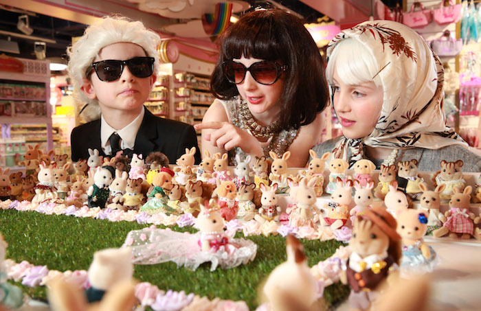 EDITORIAL USE ONLY L-R - Rufus Rumford, aged 8, dressed as Karl Lagerfeld, Connie Davies, aged 10 dressed as Anna Wintour and Chloe Sweeting, aged 9, dressed as The Queen, on the front row at the opening of the world's smallest fashion show. The event was to celebrate the launch of the new Sylvanian Families Town at Hamleys Regent Street in London. PRESS ASSOCIATION Photo. Picture date: Thursday March 22, 2018. Photo credit should read: Matt Alexander/PA Wire