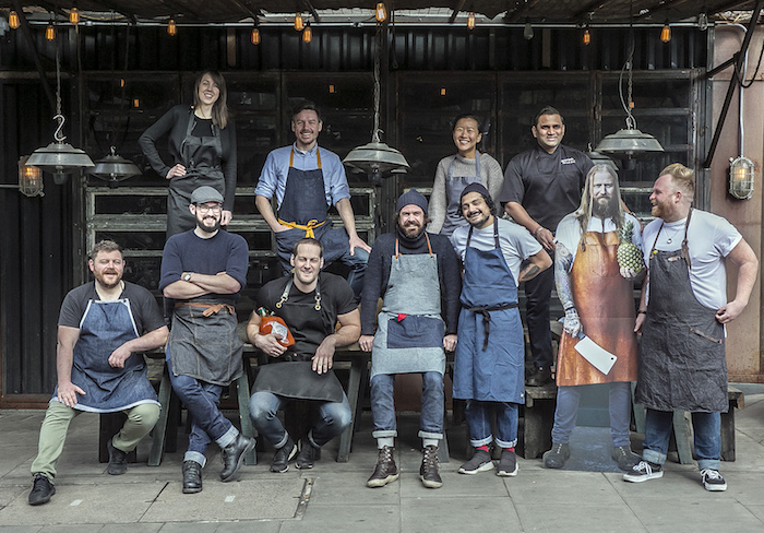 TABASCO® Brand teams up with an incredible line up of London's chef and bartender talent for a one-off night market-style event on 11th May in East London to celebrate the 150th anniversary of TABASCO® Sauce. (Spot the chef that couldn't make the photo shoot!) 150 tickets to the private 'TABASCO Global Kitchen' party have been released to the public to celebrate with fans. Back row, left to right; Rachel Hugh (The Vurger Co), Nicholas Balfe (Salon), Mikyung Jeong (Jinjuu), Nirmal Save (Gunpowder) Front row, left to right; Simon Lamont (Rocks Oyster Grill), Conor Pearson (Oyster Boy), David Carter (Smokestak), Chris Whitney (Breddos Tacos), Nud Dudhia (Breddos Tacos), Andrew Clarke (cut-out!) (Brunswick House, Jim's Cafe and St Leonard's), and Shaun Whitmore (Berber & Q Grill House) Please credit TABASCO® Brand