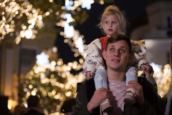 EDITORIAL USE ONLY Serghei Coscodan and his daughter Davinia aged 4 at the iconic Seven Dials monument in the heart of London's West End for the Christmas lights switch on. PRESS ASSOCIATION Photo. Picture date: Thursday November 15, 2018. The event featured live music from the EP Orchestra and was hosted by Emma Conybeare. Photo credit should read: David Parry/PA Wire