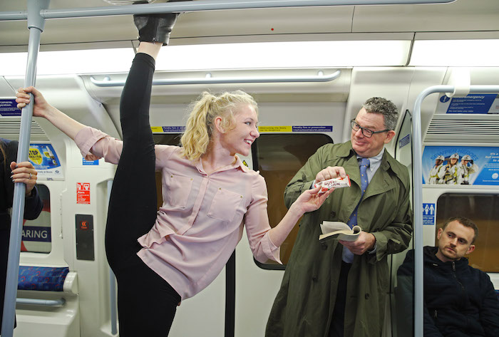 Commuters were treated to an acrobatic performance by professional acrobats in Charing Cross in a campaign by Nutri-Grain to launch a new recipe for Nutri-Grain bars, designed to fuel busy mornings. Issue date: Tuesday November 20th, 2018. Nutri-Grain research reveals 89% of Brits experience an energy slump by mid-morning. Gymnast Abigail Mason performs a standing split in a tube carriage at Charing Cross.