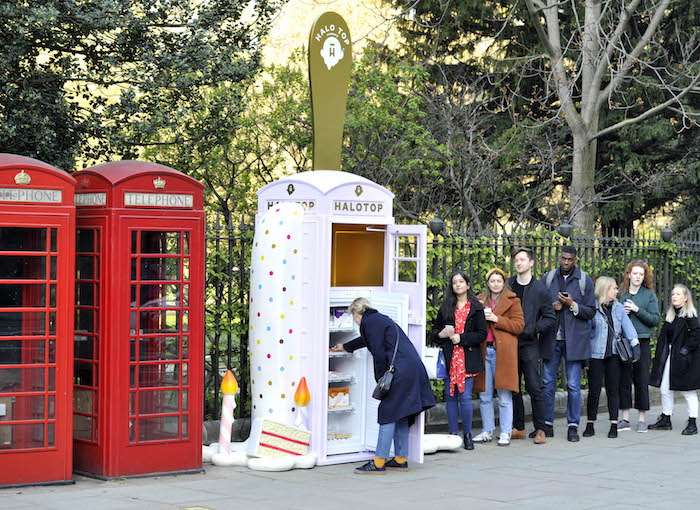Thousands of Londoners were treated to Halo Top's newest ice cream sticks, with the arrival of a Birthday Cake themed frozen telephone box in Russell Square (London) today (Thursday 11th April) and tomorrow (Friday 12th April). Passersby were able to help themselves to one of 10,000 free ice cream sticks from within the brand's unique telephone box. For more information, head to halo top.uk/new Media contact - halotop@eulogy.co.uk - 0203 077 2000 This photo may only be used in for editorial reporting purposes for the contemporaneous illustration of events, things or the people in the image or facts mentioned in the caption. Re-use of the picture may require further permission from the copyright holder. Photo credit should read: Adrian Brooks/Imagewise