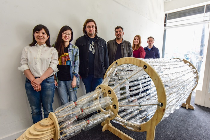 Ship in a Bottle art work, by Ayako Tani, (left) Glass Artist, Research Fellow, University of Sunderland, pictured with some of those that helped.