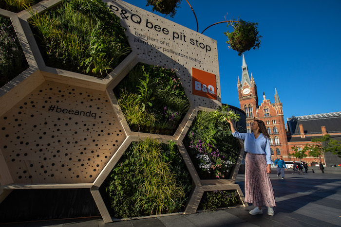 B&Q unveils a huge 'Bee Pit Stop' at London King's Cross Station to raise awareness of the decline in the UK's bee-friendly habitats and calls on the nation to plant a million more bee-friendly spaces. The billboard is the first of many bee pit stops being created by B&Q, with pollinating roundabouts springing up around the UK from June.