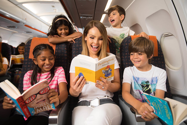 EMBARGOED TO 0001 WEDNESDAY JULY 10rEDITORIAL USE ONLYr(Left to right) Marissa Patel, aged 10, Deeana Patel, aged 4, Hugo Southy, aged 5, and Lucas Brooks, aged 9, join Katie Piper to launch easyJetÕs ÔFlybrariesÕ campaign, a unique inflight book lending initiative that aims to encourages kids to read for fun over the summer, at London Luton Airport. PRESS ASSOCIATION Photo. Issue date: Wednesday July 10, 2019. New research reveals that three-fifths of children would swap 30 minutes screen time for a story read by mum or dad so in response the airline has produced a fleet of onboard lending libraries that will serve over 20 million passengers with over 60,000 books stocked on more than 300 aircraft. Books published by HarperCollins ChildrenÕs Books including; Dinosaur Juniors, Mog and Bunny, Paddington Abroad, The Boy Who Could Do What He Liked and Geek Girl will be made available in passenger seat-pockets of all easyJet flights departing the UK this summer. Photo credit should read: David Parry/PA Wire