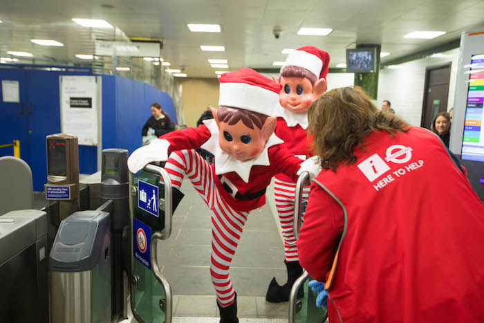 EDITORIAL USE ONLY TFL staff member Zelis with Elfie and Elvie from UK toy brand Elves Behaviní Badly who were causing mischief around London in the run up to Christmas. PA Photo. Picture date: Monday November 25, 2019. The naughty elves are asking parents and children to prank their friends, family and co-workers with their own elf dolls this year and post them online with the hashtag #NoElfControl. The festive doll range, which launched in 2017, has sold around 5 million elves to date. Photo credit should read: David Parry/PA Wire